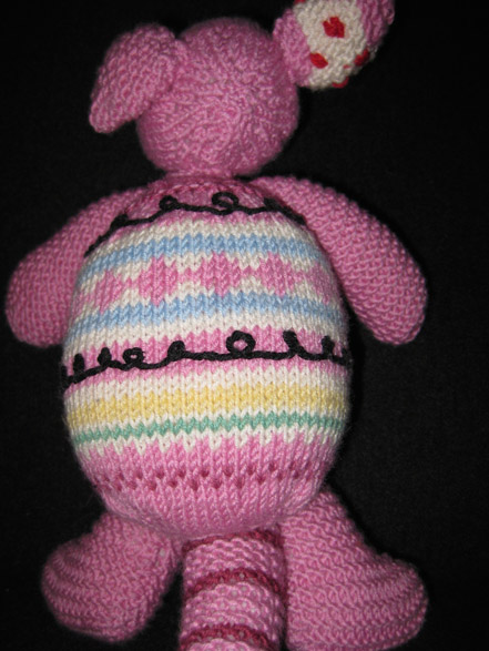 Milo Armadillo knitted doll back